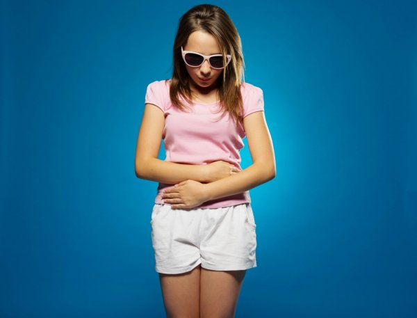 Young girl with a stomach ache — Stock Photo