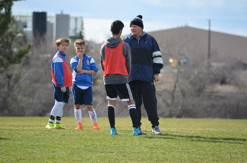 Soccer coach and player asking each other questions