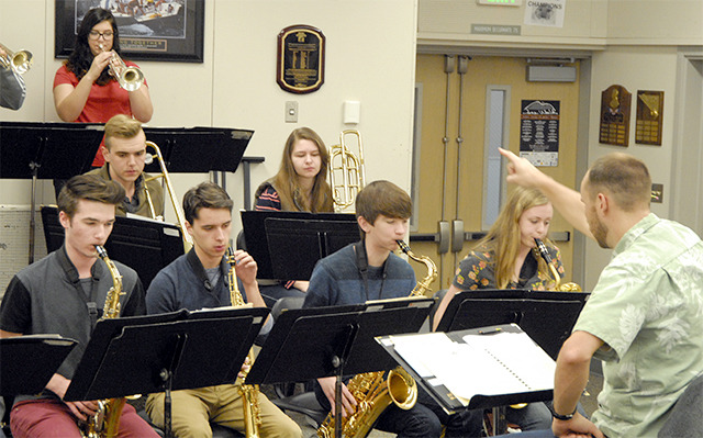 "Mount Si High School Jazz Band I director Matt Wenman, right, cues his students in rehearsal for the band's upcoming ""Hot Java Cool Jazz"" concert performance. Last week, Jazz at Lincoln Center announced that Mount Si was chosen for a return trip to the annual Essentially Ellington festival. - Carol Ladwig/Staff Photo"