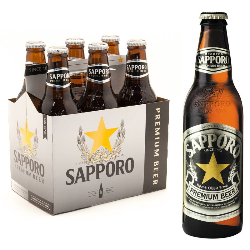 6-Pack of Sapporo Premium Beer bottles next to a single bottle