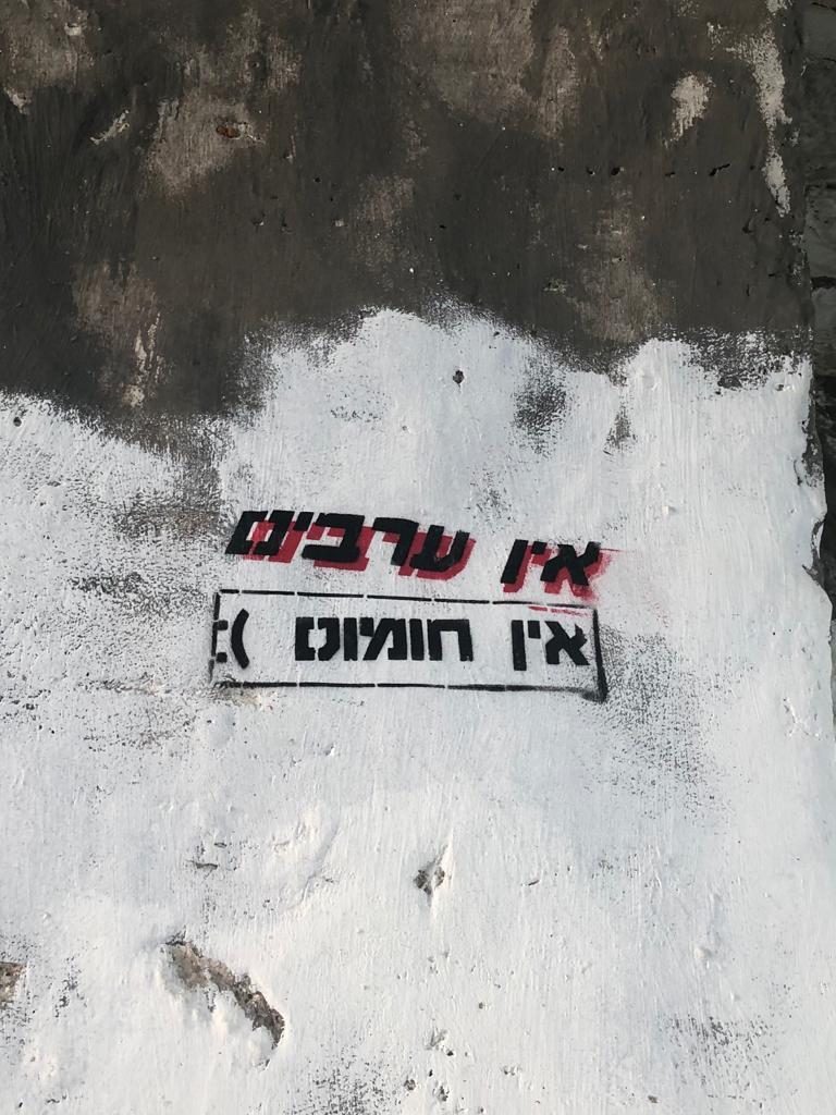 Graffiti on a wall  Description automatically generated