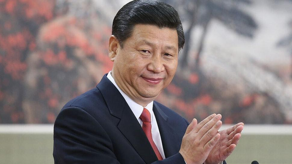 BEIJING, CHINA - NOVEMBER 15: Chinese Vice President Xi Jinping, one of the members of new seven-seat Politburo Standing Committee, greets the media at the Great Hall of the People on November 15, 2012 in Beijing, China. China's ruling Communist Party today revealed the new Politburo Standing Committee after its 18th congress.
