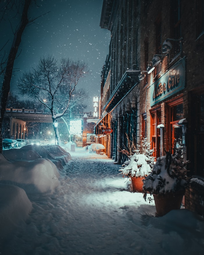 City sidewalk during a snowstorm