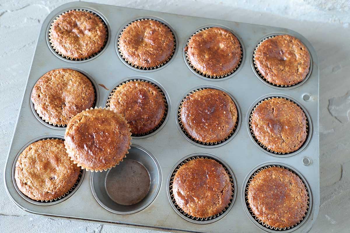 banana nut muffins in baking tin