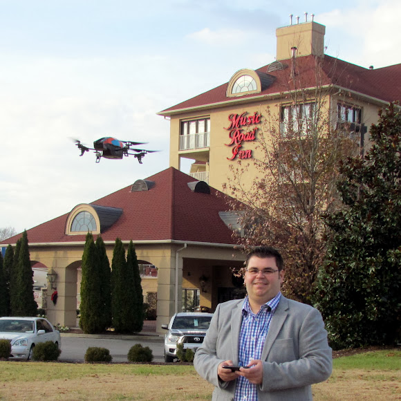 Joe Smith of FreeHotelCoupons.com pilots a drone from his iPhone