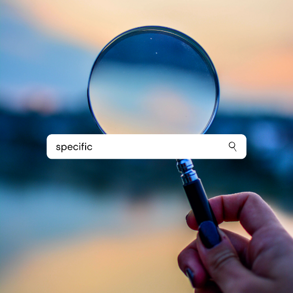 A person holding a magnifying glass  Description automatically generated with medium confidence