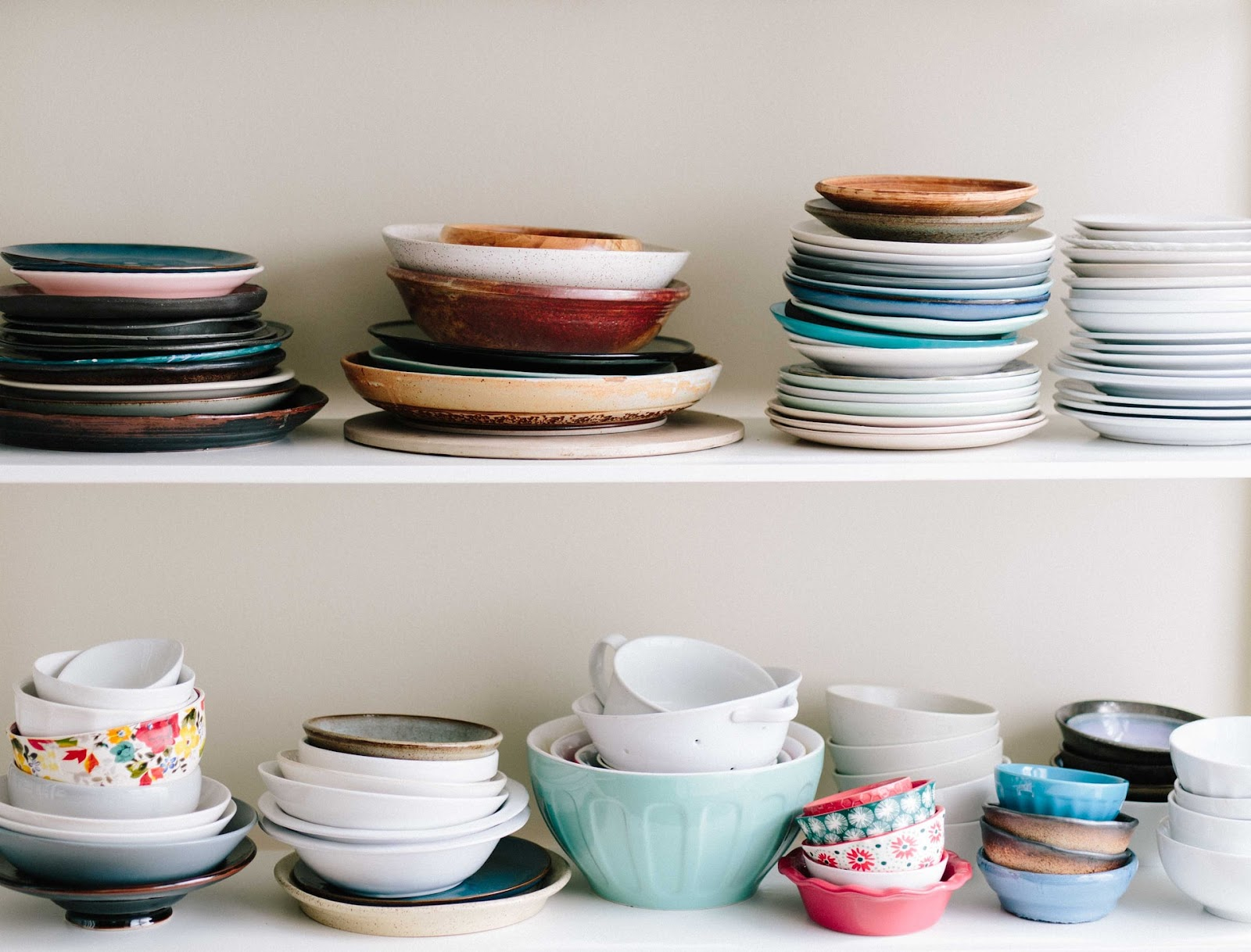 Vintage dish sets are aesthetically pleasing and can be proudly shown off in your kitchen; different kinds of bowls and dishes placed on top of each other on two different shelves