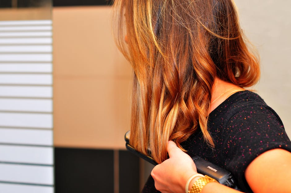Curling hair with straighteners