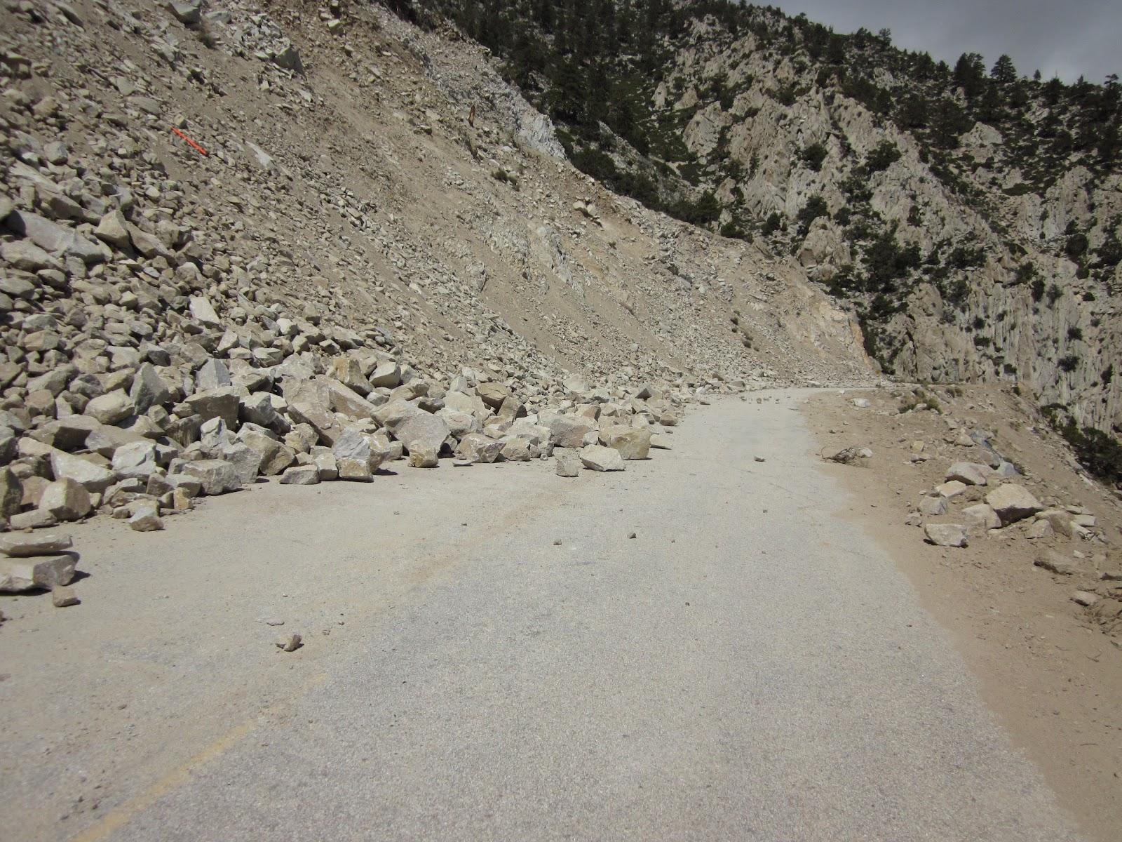 Landslide and rocks on Horseshoe Meadows road during bike climb.