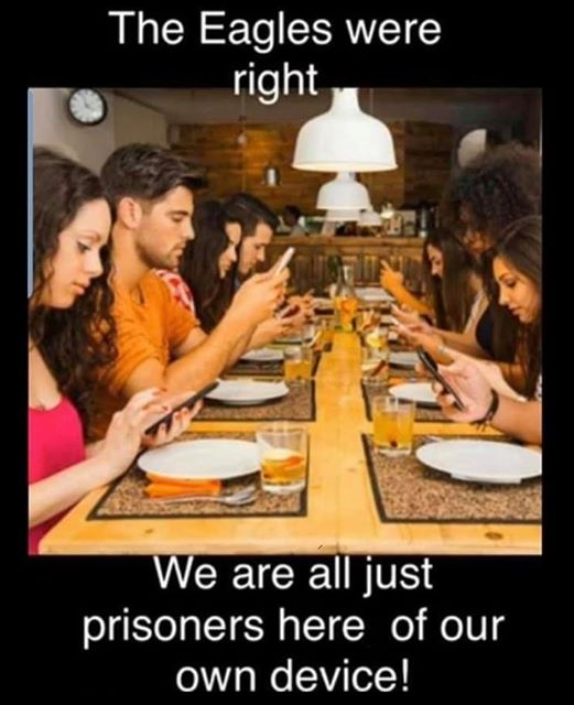 Image may contain: 4 people, people sitting, table and indoor, possible text that says 'The Eagles were right We are all just prisoners here of our own device!'