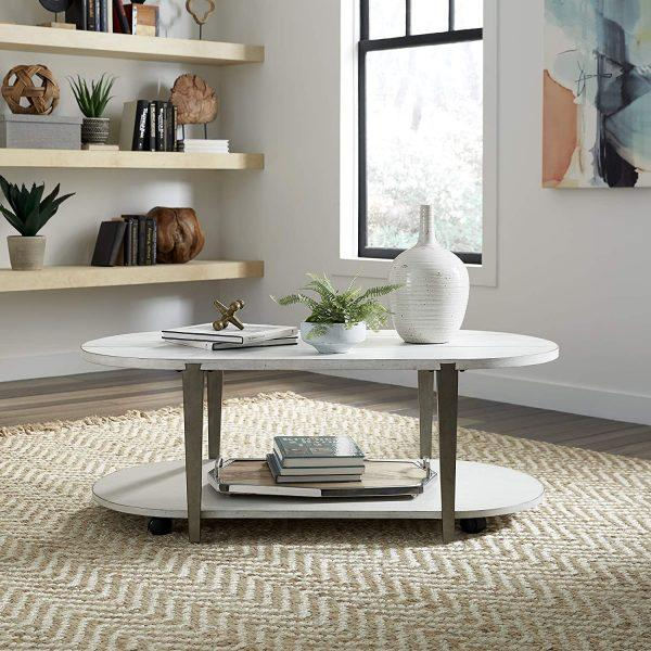 http://cdn.home-designing.com/wp-content/uploads/2021/04/antique-oval-coffee-table-with-open-lower-shelf-white-tabletops-and-metallic-wood-frame-cottage-chic-coastal-farmhouse-furniture-for-living-room-600x600.jpg