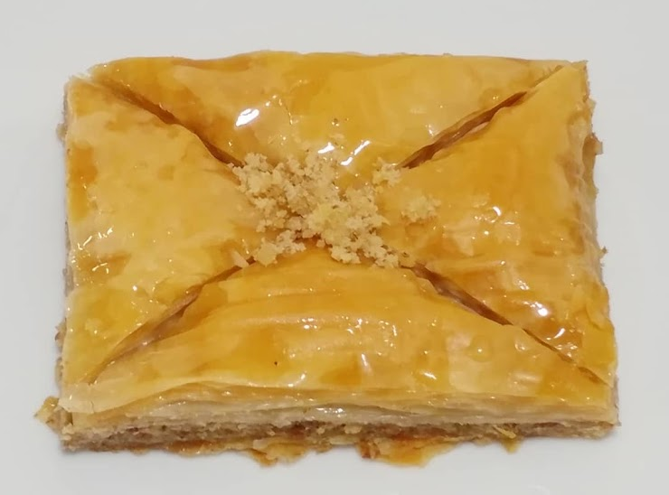 Baklava is made with rich amount of Walnut that has strong flavor, light amount of sugar syrup (with no honey) and Clarified butter.  (Vegetarian)