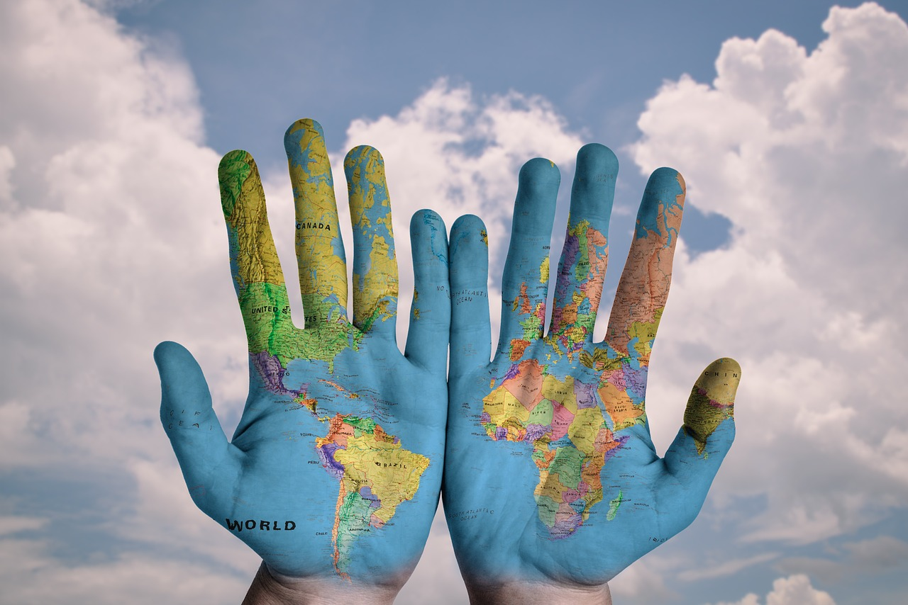 picture of hands painted with a depict of a world map,