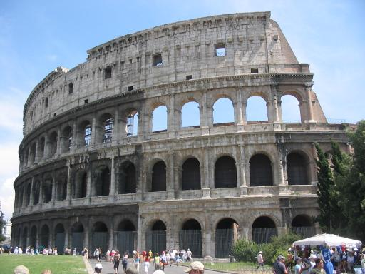 Picture of the Colosseum with contemporary tourists below.