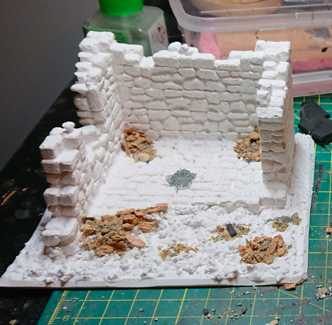 White plaster ruin mounted on foamex board with gravel and other basing materials applied