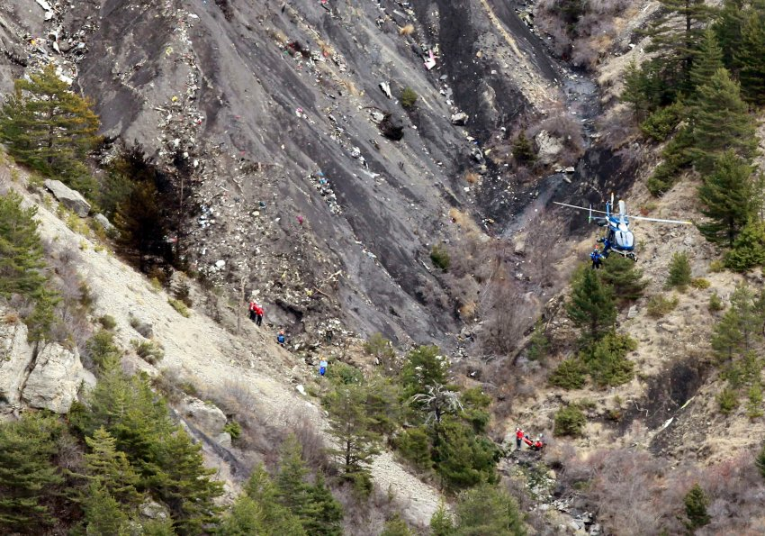 A French gendarme helicopter flies over the moutainside crash site of an Airbus A320, near Seyne-les-Alpes, March 25, 2015. French investigators will sift through wreckage on Wednesday for clues into why a German Airbus operated by Lufthansa's Germanwings budget airline plowed into an Alpine mountainside, killing all 150 people on board including 16 schoolchildren returning from an exchange trip to Spain.      REUTERS/Emmanuel Foudrot
