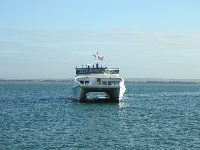 Catamarans are often used as a ferry to transport people and vehicles across bodies of water as shown in this photo.