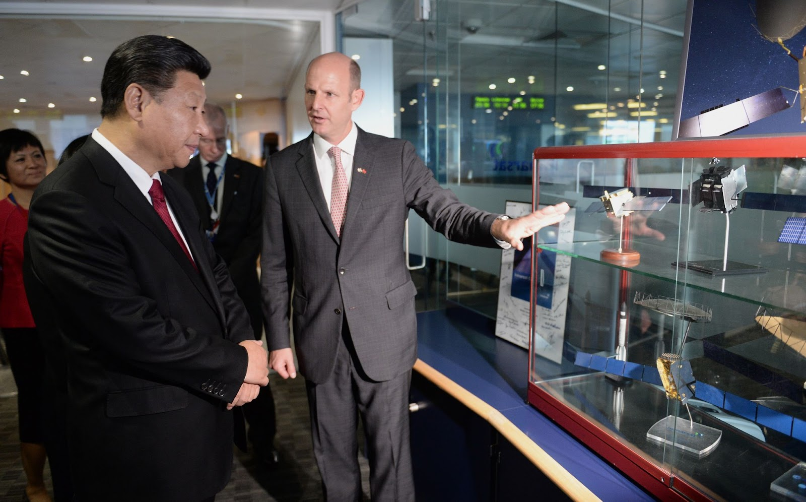 Chinese President Xi Jinping views models of satellites with Rupert Pearce, CEO of Inmarsat (R) during a visit to Inmarsat on October 22, 2015 in London, England. Recent investigations by the UK press reveal a startling buyup of Britain's technology, education, energy, and business by Chinese Communist Party-owned and linked entities.