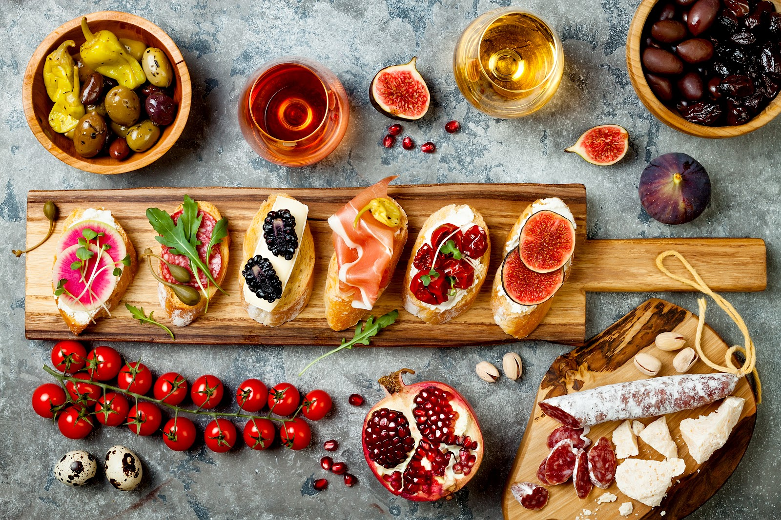 An image showing a variety of Spanish meats, tapas, and foods, all key elements of the Spanish lifestyle