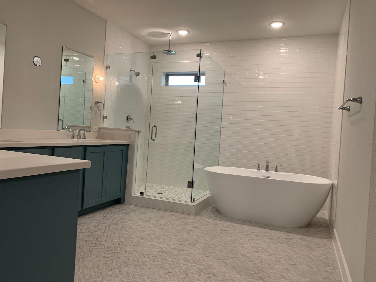 builder-grade home subway tile free standing tub vanity