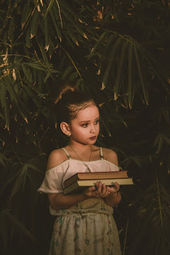 .Photo Of Girl Holding Books
