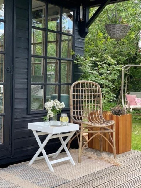 A picture containing outdoor, chair, porch, area Description automatically generated