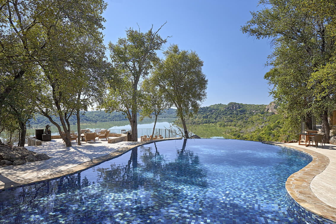 Beautiful infinity pool in Malilangwe Zimbabwe overlooking a damn