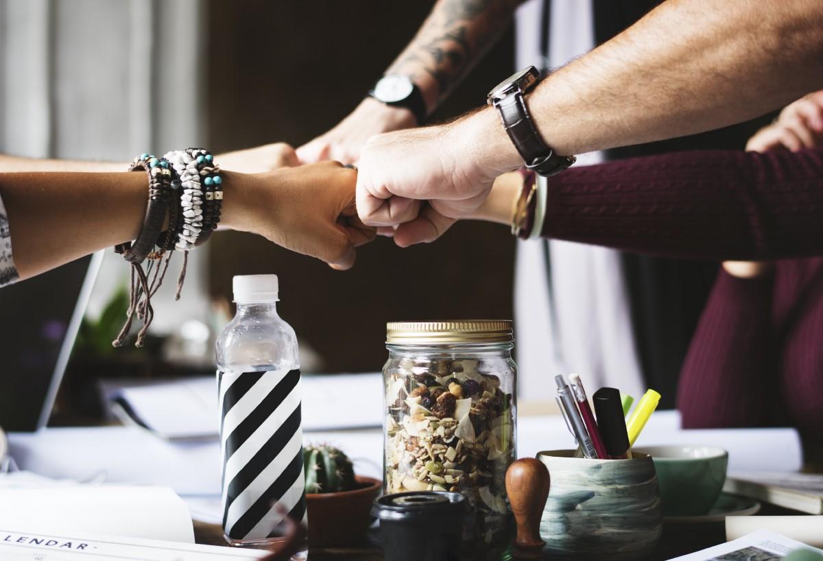 startup team fist bump