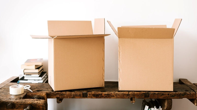 moving boxes, books, packing tape, scissors