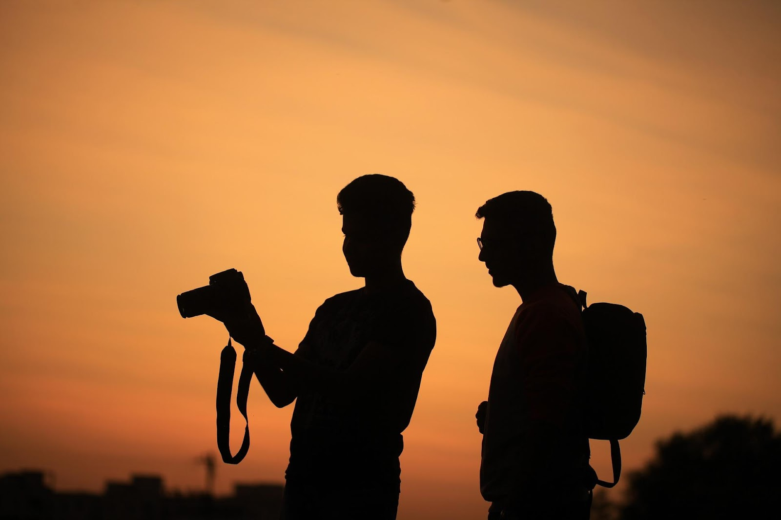 silhouette of two men