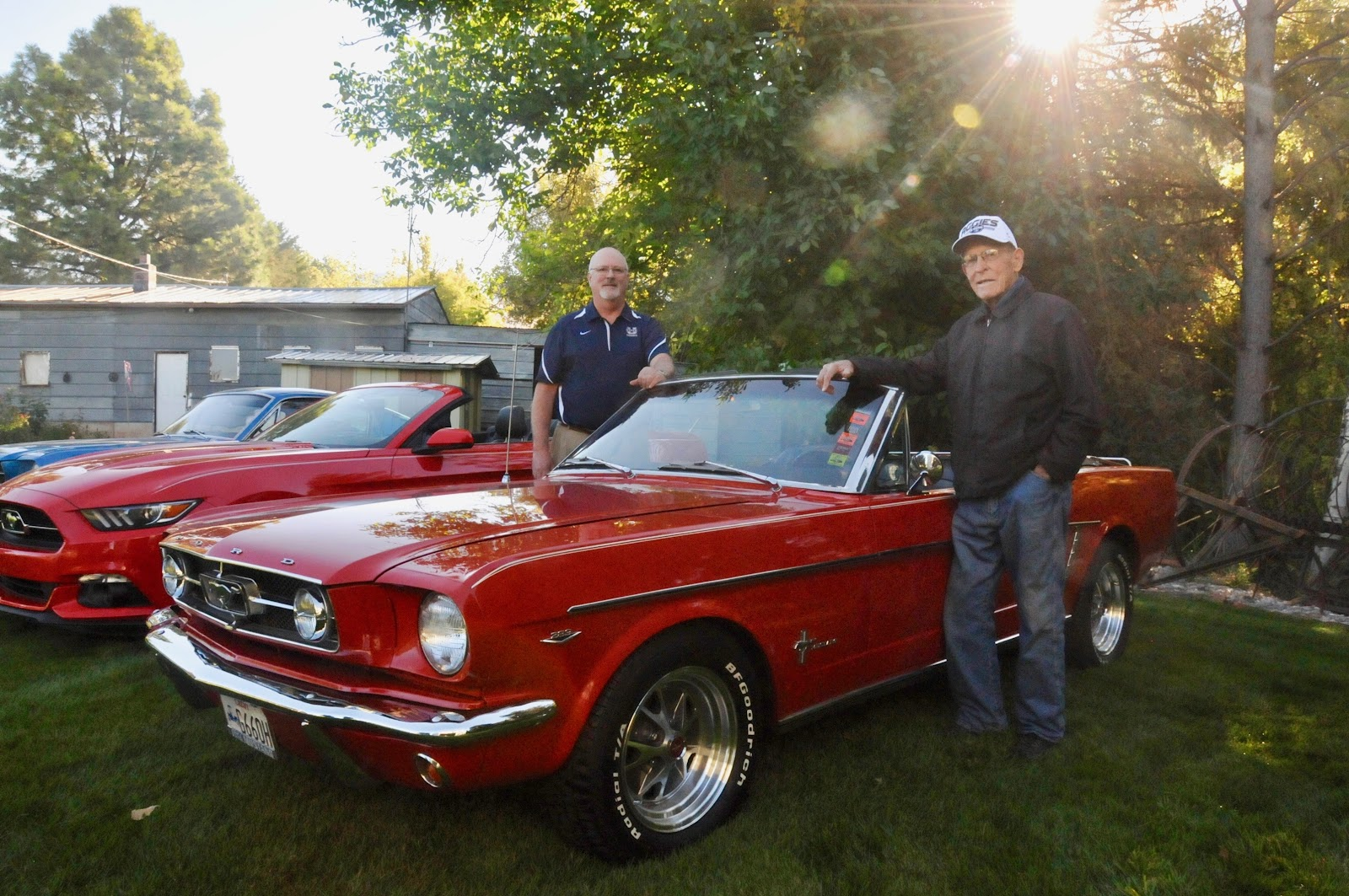 Mike bullen and his father del next to mikes 65 mustang convertible the car has been in the usu homecoming parade almost continually since 1983