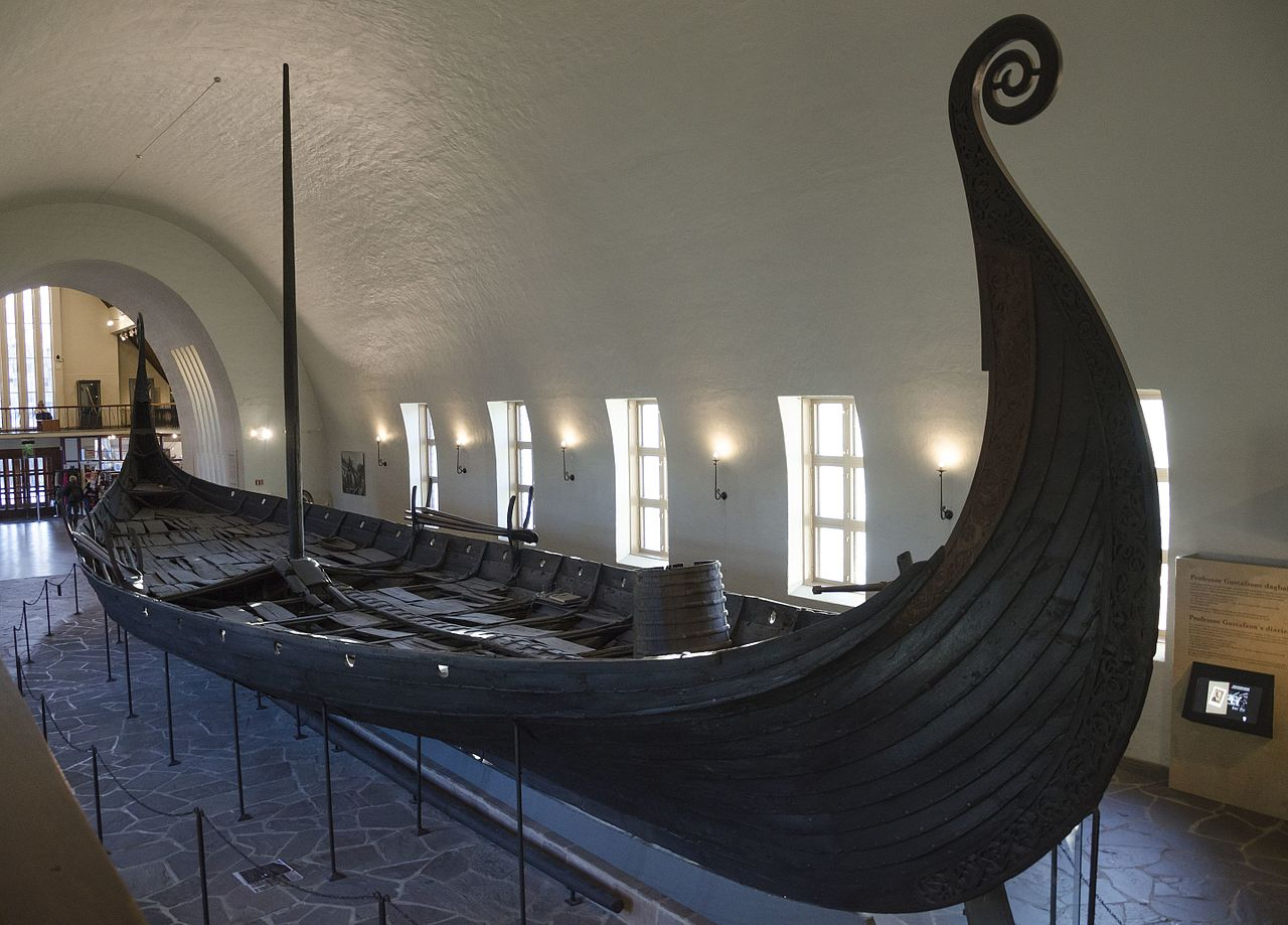 Recovered Viking longship in Norway, featuring a shallow draft, benches on which the Vikings would sit and row, and a high prow.