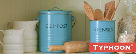 Light blue steel kitchen storage tins by Typhoon on a countertop