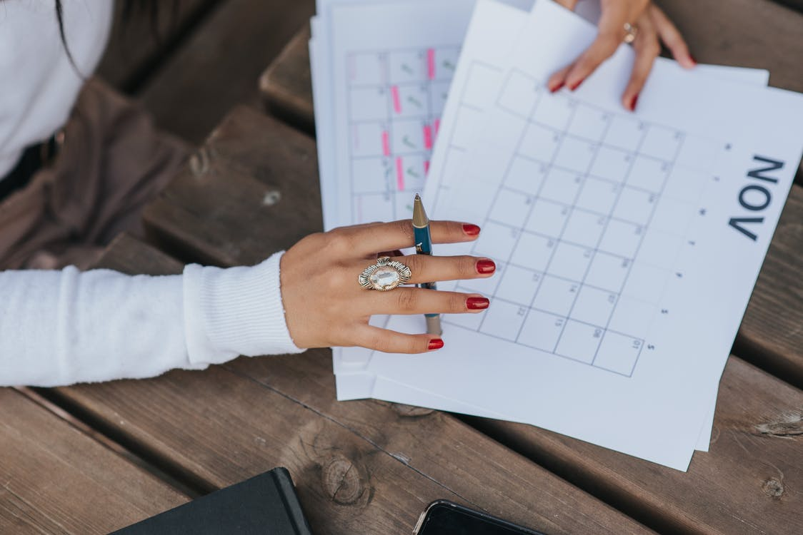Person Wearing Silver Ring and White Long Sleeve Shirt