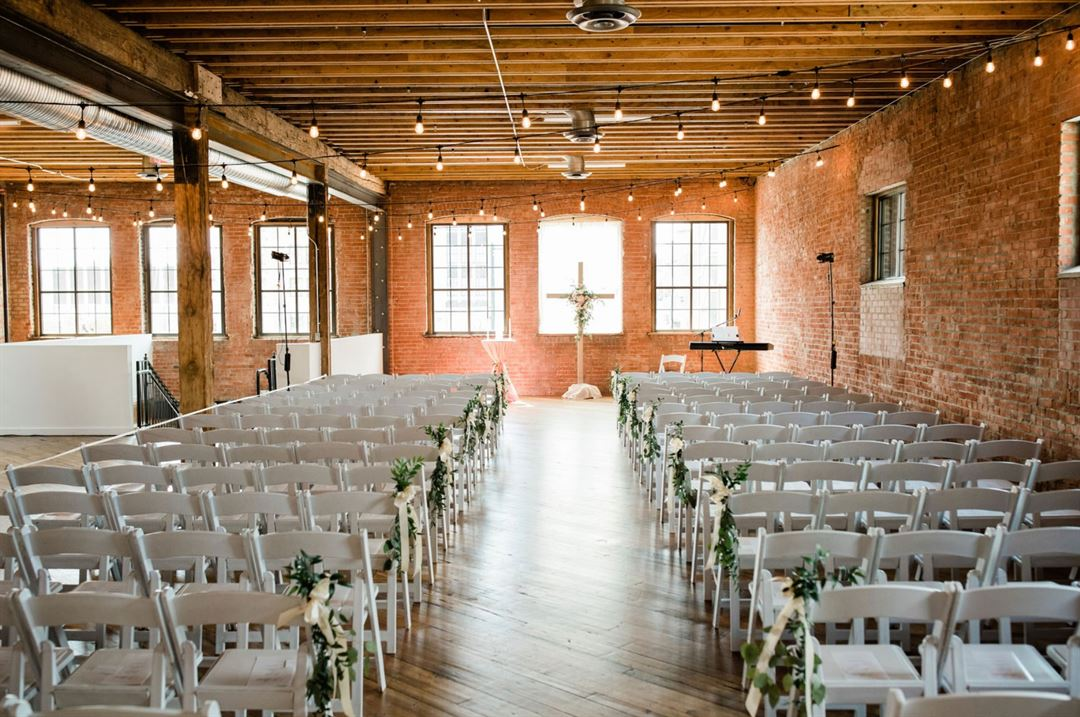 venue in refurbished factory space with hanging lights and brick wall