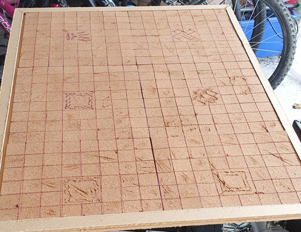 Full sized MDF base, covered with cork tiles etched into dungeon tiles.