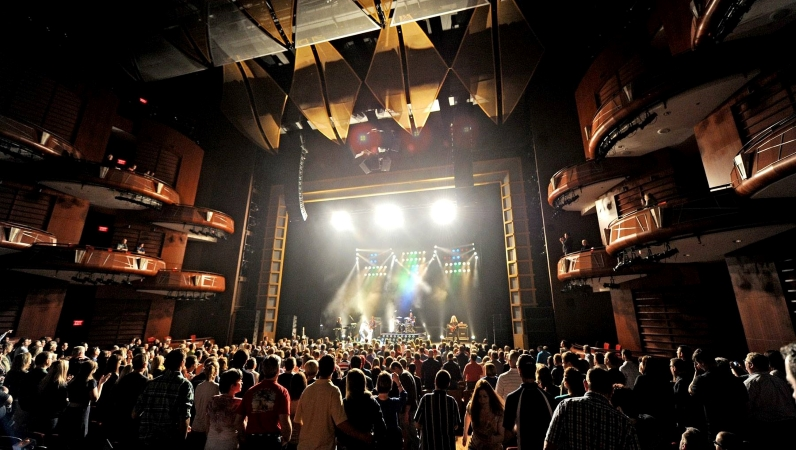An audience watches a live performance at Cobb Energy Performing Arts Centre in Smyrna, GA.