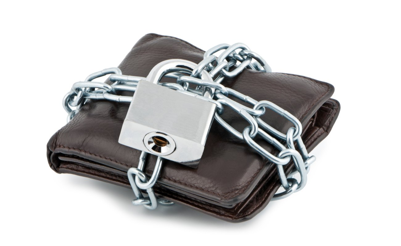 A brown wallet locked up with chains and padlock