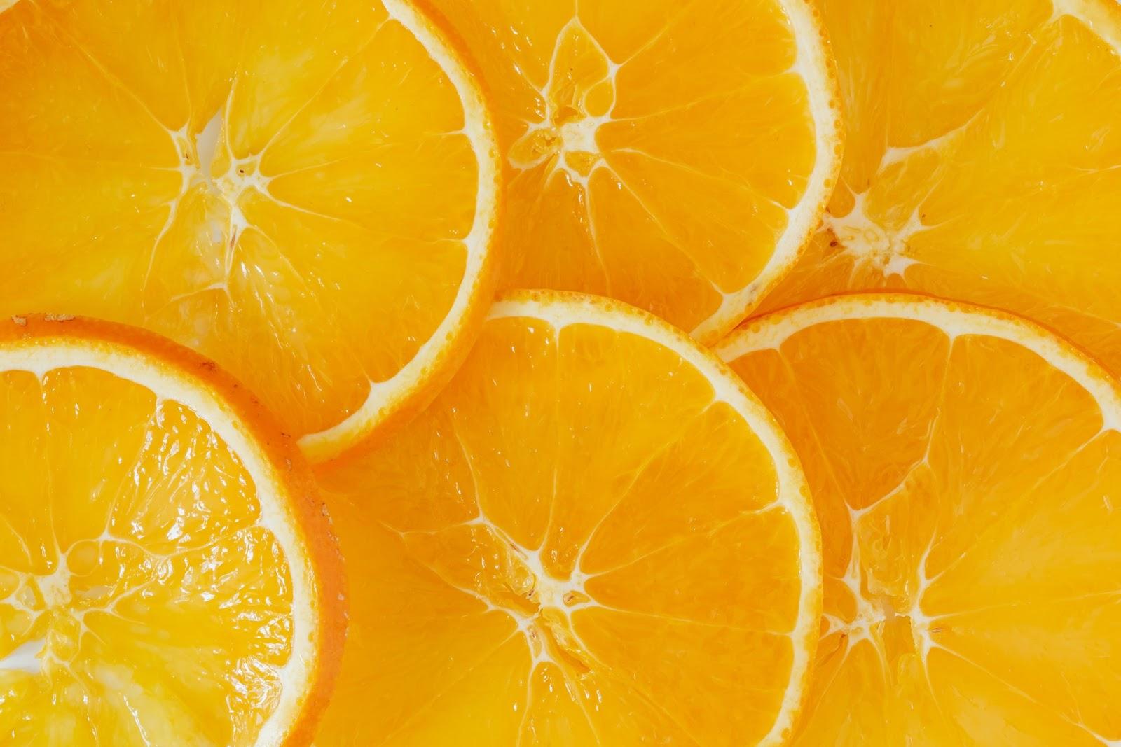 Slices of orange laid on a table.