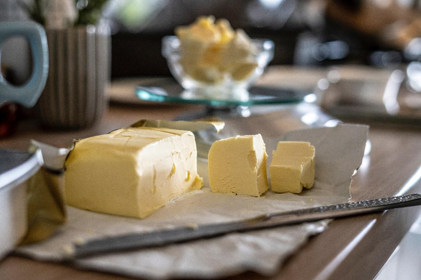 A group of cheeses on a cutting board  Description automatically generated with low confidence