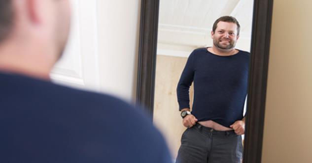 Guy wearing a shrunken sweater