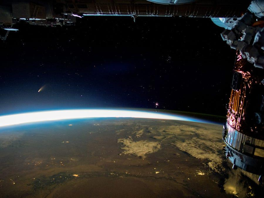 comet neowise astronaut photo orbital dawn earth international space station iss july 5 2020 ISS063 E 39875 business insider edit