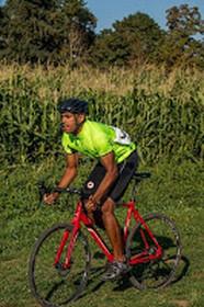 Okon cycling near a corn field.