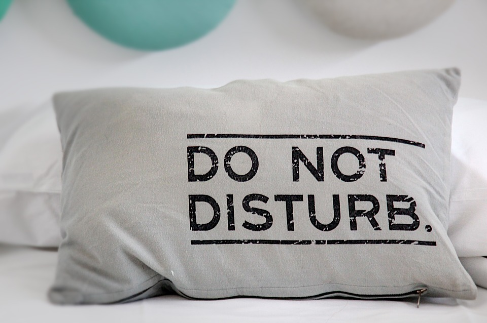 Pillow with Do Not Disturb sign