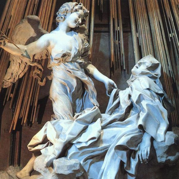 St. Teresa in ecstasy with an angel looming over her holding a golden spear.