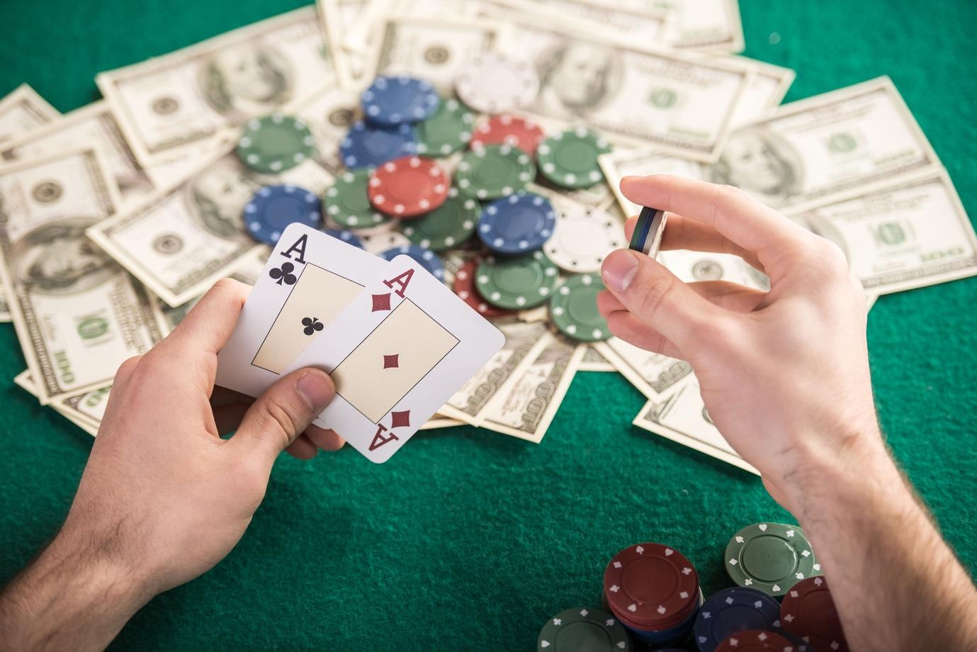 A picture containing text, person, indoor, gambling house  Description automatically generated