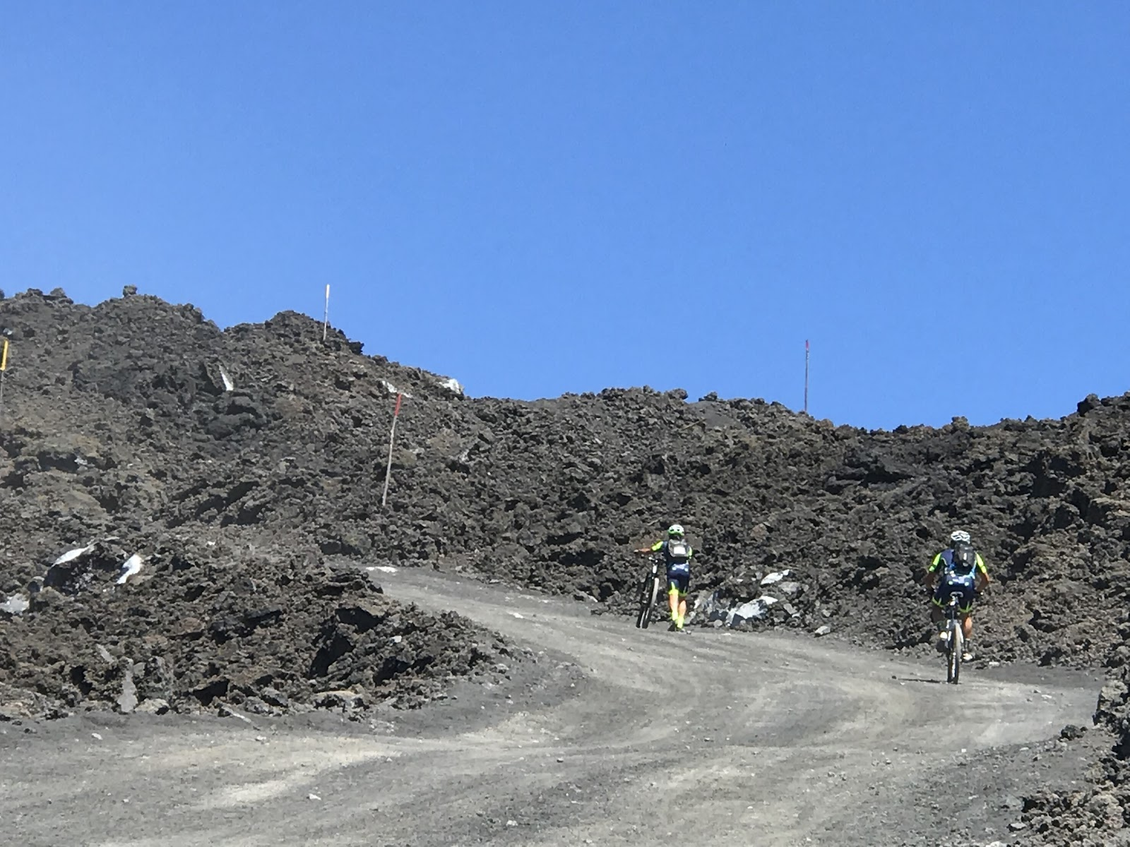 2 mountain bikers on gravel and dirt road to Mount Etna