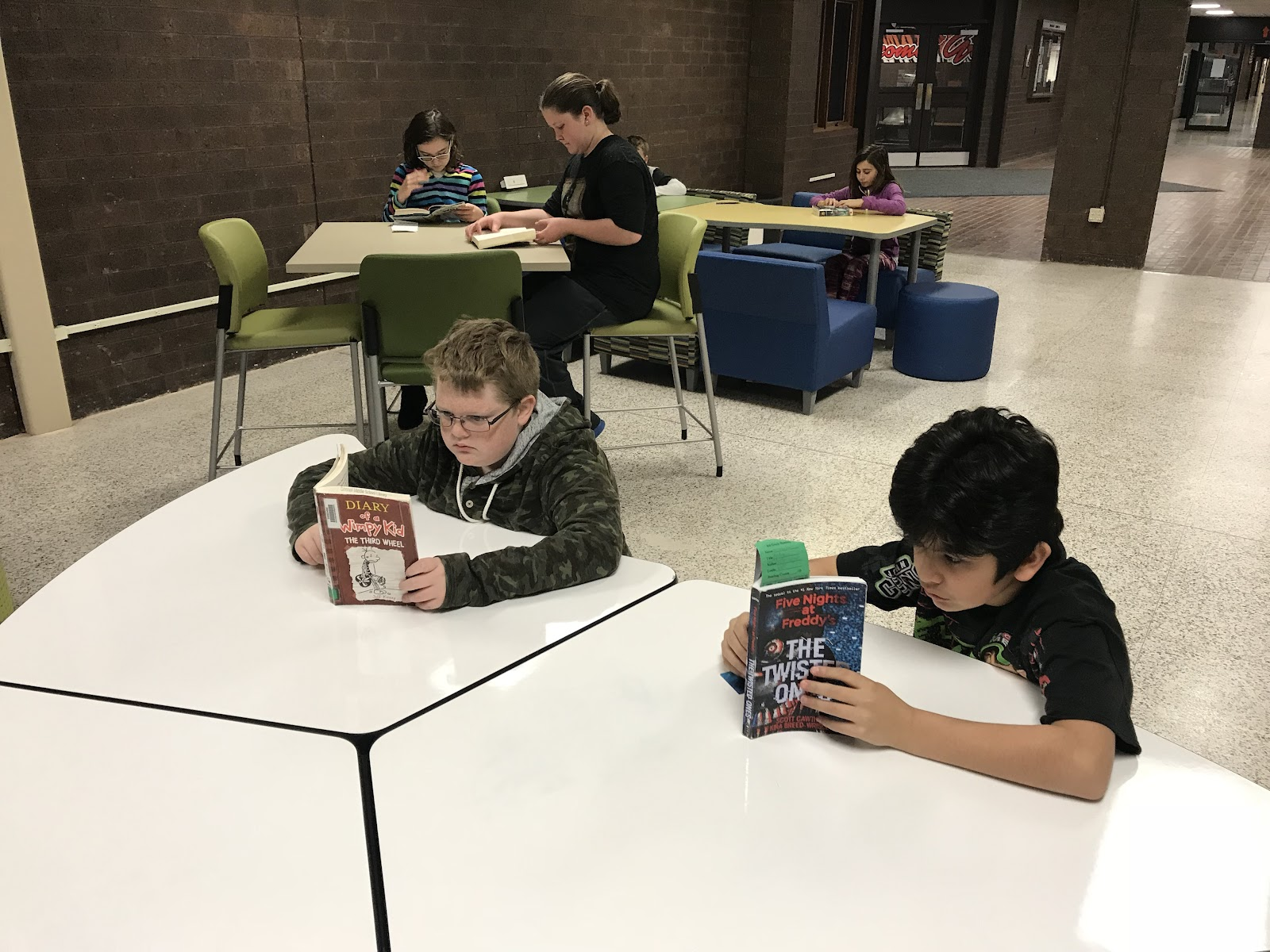 Middle School Students and Staff finding time to work together, read together, or learn together!
