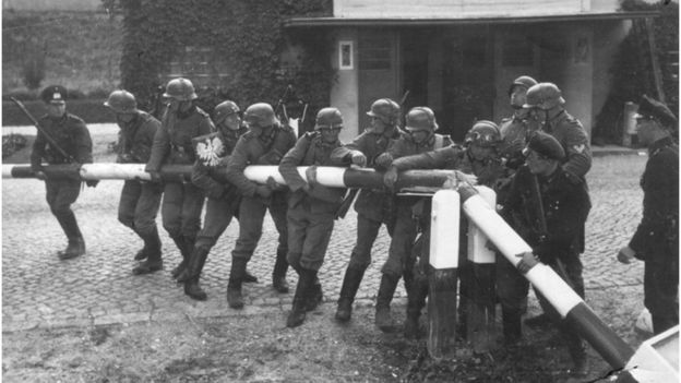 German Soldiers breaking down the border barrier and crossing into Poland at Sopot on September 1, 1939. (Photo by Universal History Archive/Getty Images)