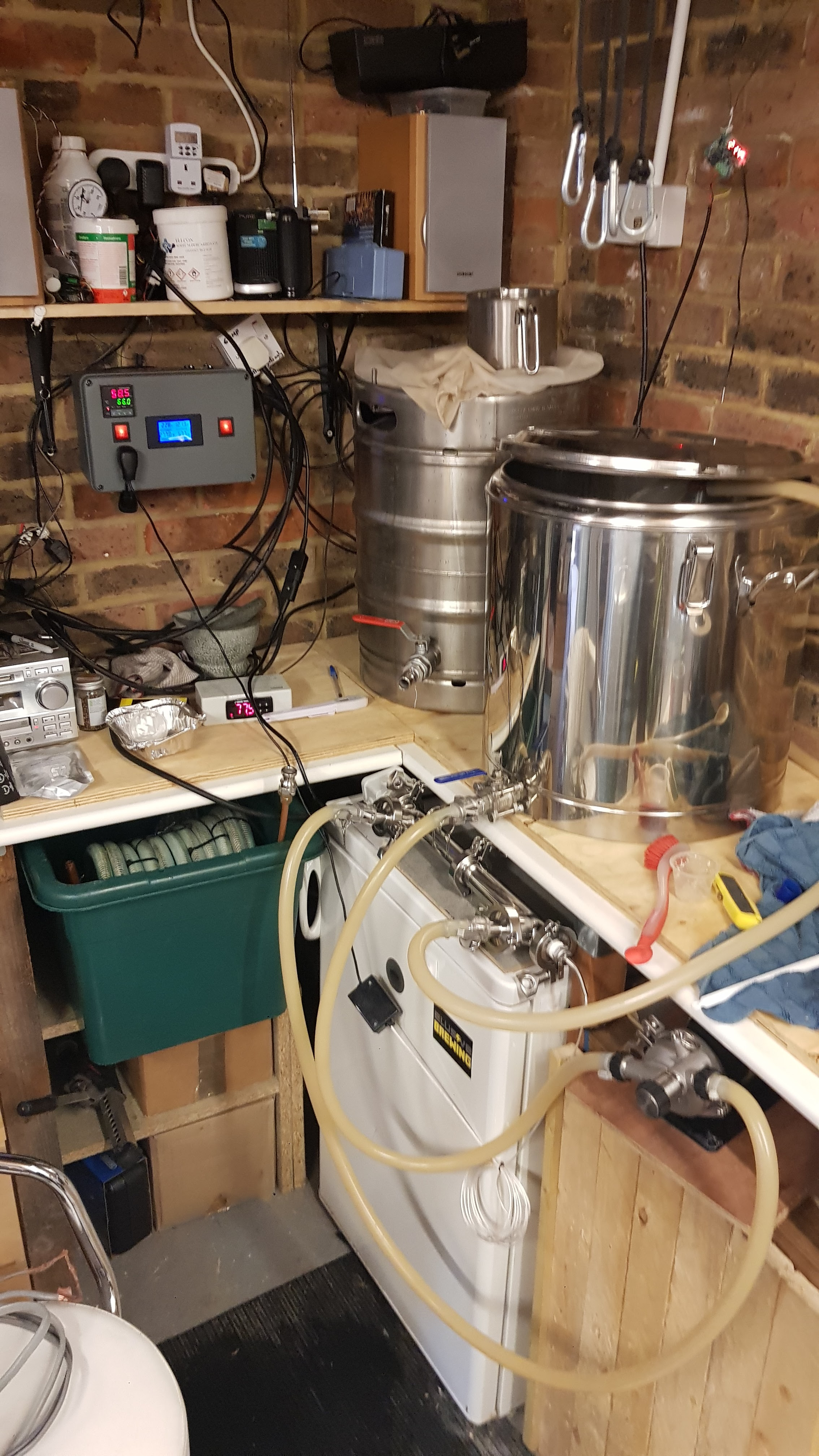 Image of a RIMS tube and control panel in a home brewery setting